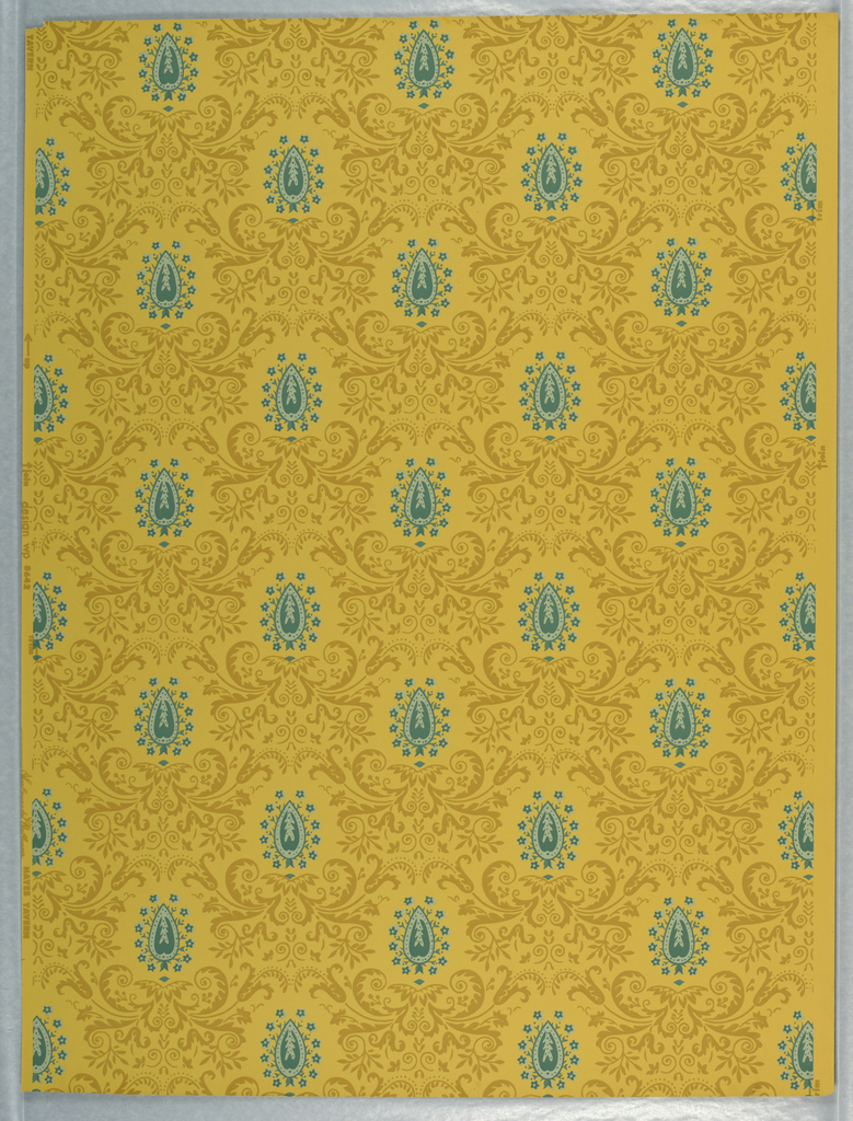 Symmetrical scroll motif in mustard yellow, surrounding blue palmettes, on lighter mustard ground. Drop repeat, straight match (original coloring).