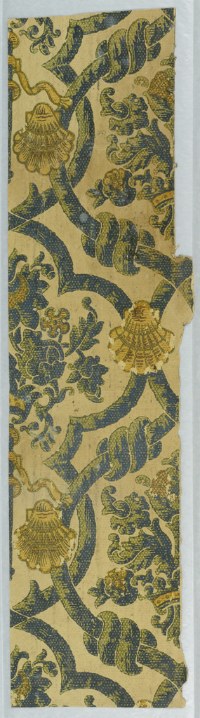 Framework of vines with shells containing stylized floral and foliate medallion. Printed in olive green, black and ocher on tan ground.
