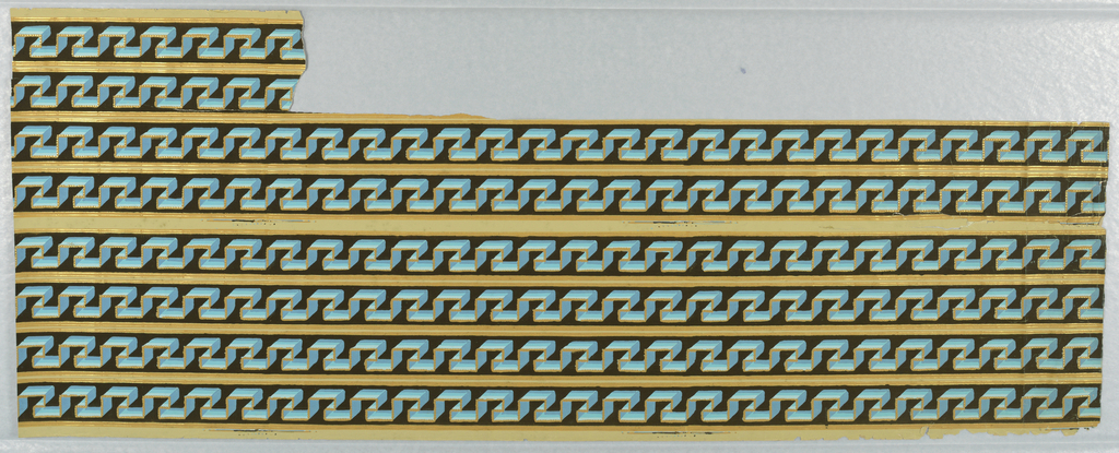 Six full lengths of borders with two shorter sections. Greek key design with three-dimension effect. Beading along one edge. Printed in blue and orange on black ground.