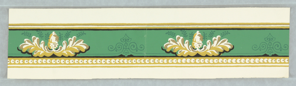 On bright green ground with darker green linear scrolls and leaves, acorn and leaves in yellow and metallic gold. Edging lines black, yellow and metallic gold; beading along bottom edge.