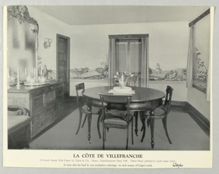 Black and white photograph of room interior showing La Cote de Villefranche in situ in a dining room setting.