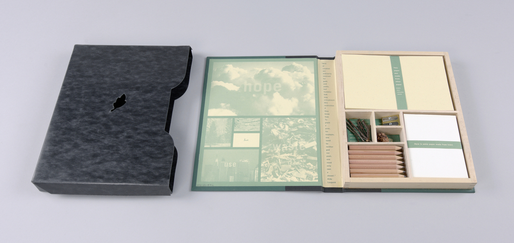 The design program focuses on environmental issues. Book, front and back covers: Dark green cloth; spine bound in black cloth, extending about two inches each onto front and back. Front cover: Imprinted a primer in metallic gold lower case, serif-style type, centered; underneath, also centered, is a small ideogram of a globe.  Spine: With the object laid flat, back cover down, a primer is repeated, styled in a smaller version, and accompanied on either side by thin gold lines, gradually narrowing from the center outward; with the object standing, imprinting in gold, M&Co/ Vol.6, at the bottom edge, may be viewed. Inside left cover: The design, in tones of green and off-white, consists of five photographs and one blank space, all arranged within an outer border; the six individual components vary in size and are bordered as well; five are labeled with one word in a sans serif type, while the blank space is labeled in script. An illustration of cumulus clouds, imprinted hope, comprises the upper half of the page. In the lower half, the largest illustration, on the right, depicts construction or other debris and is labeled waste; the next largest, in the bottom half of the lower left, imprinted use, shows a Manhattan skyline scene including the Chrysler building; the three remaining are, on the upper left of the lower half, a park scene, labeled think; and next to it, top, a view of what appears to be a despoiled land or water site, imprinted die; and under that, a blank space labeled live.  Inside spine: A quotation extolling the act of planting is imprinted, one word per line, from top to bottom, ending in the author's name, Aldo/ Leopold. Inside right cover:  An uncovered wooden box, fastened here, is divided into compartments configured identically to the bordered views on the left. Each compartment contains an object, accompanied underneath by a quotation or, in one case, an illustration; the color scheme is the same as on the left. In the upper half, a stack of p