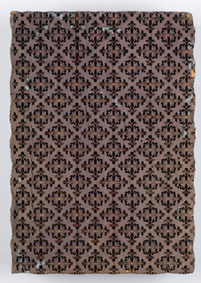 Wooden block for printing fabric. Design in relief of a diamond lattice. On back, holes carved for printers' hands. Contemporary picture hangers attached.