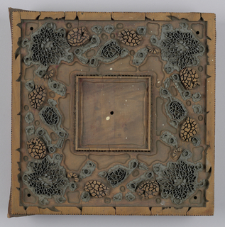 Square wood block for printing handkerchiefs. Set with metal design of flowers and birds, and with carved wood relief.