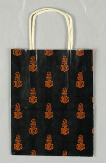Store name and logo of lion's head; small repeated patterns in orange on black.