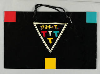 """Biblio Tee"" in white triangle and four letter Ts in triangle, below;  glossy red, yellow and blue on black background."