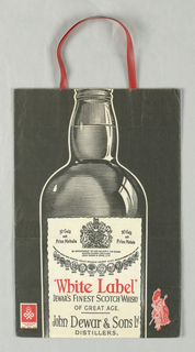 Image of scotch bottle in black and white with some red on black background; vertical format.