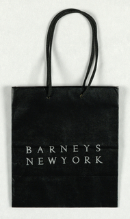 """BARNEY'S"" in metallic silver,  centered on black background in lower part of bag."