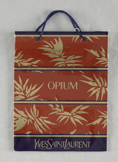 """Glossy brown and purple perfume bag with gold pointed leaves and gold and purple stripes.  Perfume name, """"OPIUM"""" in gold, center. Base: Made in France."""