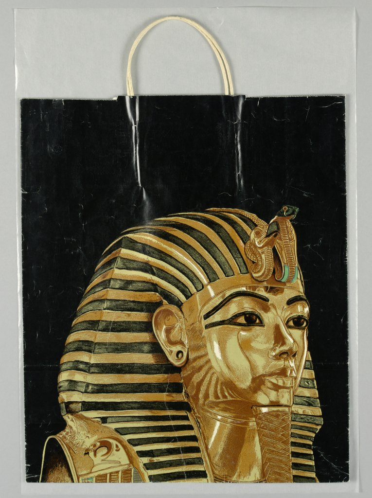 "Treasures of Tutankhamun-De Young Museum. Text on side panel in white. Black, gold and turquoise image of  ""King Tut."""