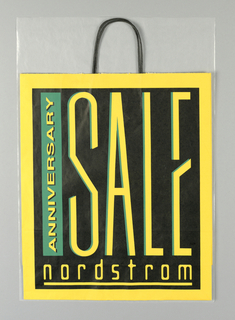 """ANNIVERSARY/SALE"" on yellow background;  black box with text dominates center; store name, underlined, along bottom. Side panels: Store name in green on black."