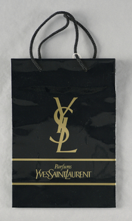 """Recto: """"Parfum Yves Saint Laurent"""" in gold between horizontal gold lines. Verso: """"YSL"""" vertically in gold."""