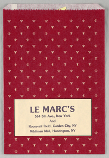 "A cream rectangle outlined in black appears at the bottom of the shopping bag. It contains the following text, printed in black: LE MARC'S / 564 5th Ave., New York / And / Roosevelt Field, Garden City, NY / Whitman Mall, Huntington, NY. The remainder of the bag consists of a repeated pattern of small abstract white flowers against a dark red background. Verso: Includes the text ""When you care enough to send the very best. Hallmark"" in black lettering inside a gold rectangle."