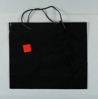 "Red squares on black bag. Side panels: ""Ward Bennett Designs for Brickel Associates"", with location information."