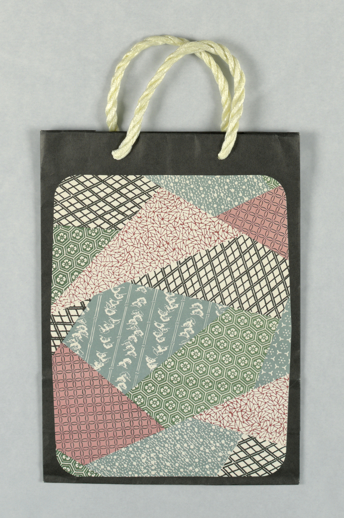 """Small """"charm bag"""". Photo reproduction of typical Japanese papers in pink, black, green, and blue on black background."""