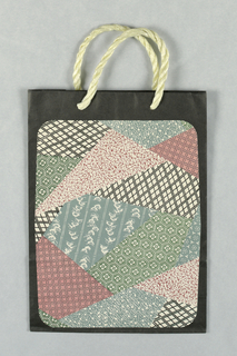 "Small ""charm bag"". Photo reproduction of typical Japanese papers in pink, black, green, and blue on black background."