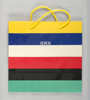Glossy paper; yellow, navy, white, red, black, and green horizontal stripes with  firm name in center.