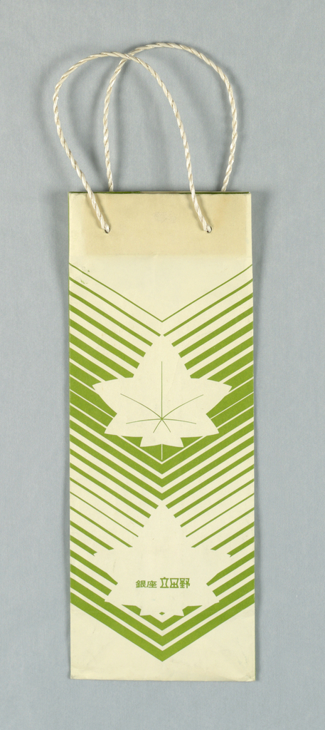 Small oblong white bag with green chevron stripes and two maple leaves. Japanese text on bottom and side panels.