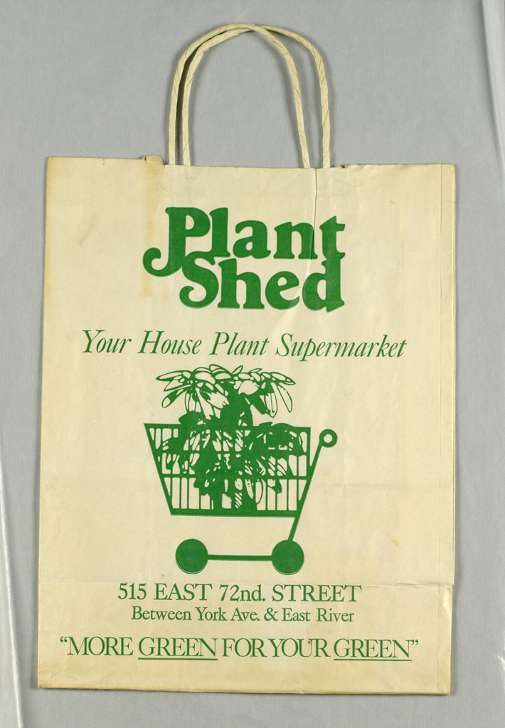 """""""Plant/Shed/Your House Plant Supermarket"""" in green; green image of plant in shopping cart on cream background; address below."""