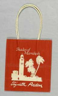 Rust-colored bag with ivory drawing of palm trees, wall, and minaret.  Firm name at bottom.