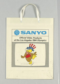 "Recto: ""Sanyo-Official Video Products of the Los Angeles 1984 Olympics"" in blue. Illustration of bird dancing and Uncle Sam hat. Verso: Olympics logo."