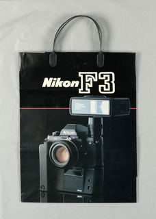 """Nikon F3"" in text on black; photo of camera on glossy black. Product name repeats in black on white in side panels."