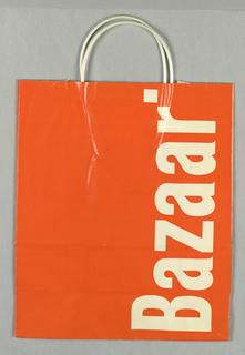 """""""Bazaar"""" vertically on right, in white on orange background."""
