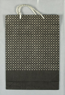 Black and white weave-like pattern formed by alternating rows of dots and crosses; without text. Japanese phrase on bottom panel. Vertical format.
