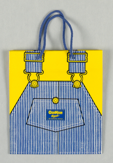 "Blue and white pinstriped children's overalls on yellow background.  Trademark logo, ""OSHKOSH/ B'GOSH/ THE GENUINE ARTICLE"",  on center pocket of overall."