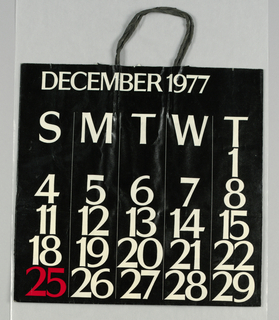 """December calendar page; white numbers, except """"25"""" in red, on black background."""