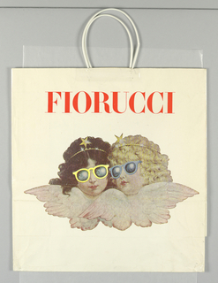 "Two cherub heads, wearing sunglasses and tiaras, in clouds.  Full color on white background with ""Fiorucci"" name in orange across top. Side panels: repeat of cherubs design in miniature, with information on the Fiorucci stores added."