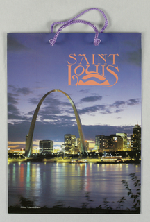 "Color photo reproduction of cityscape, showing river with riverboat and St. Louis landmark Gateway Arch, designed by the architect, Eero Saarinen. Imprinted in red, upper right: ""ST. LOUIS"". Side panels: ""Saint Louis"", in script."