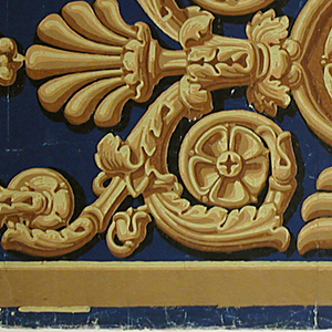 Border design simulating a gilt bronze mount. Printed in shades of yellow ocher on a deep blue ground.  H#222
