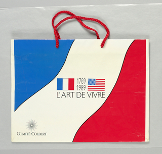 """L'ART DE VIVRE 1789-1989/ COMITE COLBERT""; ""Cooper-Hewitt, National Design Museum."" Recto: Red, white, and blue French and American flags. Verso: Stars-and-stripes flag. Side panels: Sponsors listed in black type."