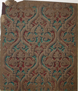 Gothic revival style design containing brown strapwork with green and maroon fills. Highlights and shadows create strong 3-dimensional effect.