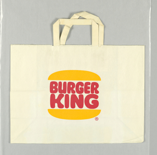 """Hamburger buns with """"BURGER/KING""""logo  in red sandwiched  between the buns, on white background."""