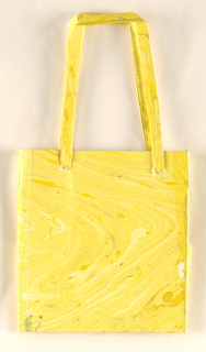 Small marbleized bag in yellows.
