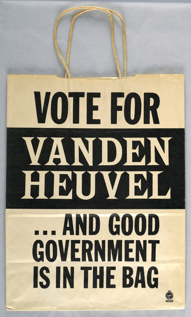 """Recto: """"Vote for Vanden Heuvel and good/ government/ is in the bag/ Union Made"""" in black and white. Verso: Large black exclamation mark."""