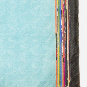 Sample book containing over 100 pages of brightly colored, bold patterns, some with multiple colorways; washable woodgrain and parquet patterns, embossed imitation embossed snakeskin and leather designs, metallic solids, coordinated borders.