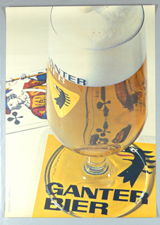 Extremely large closeup of a color photographic reproduction of a glass of beer. The Ganter logo (yellow triangle with stylized eagle's head) visible on glass which rests on a yellow and white coaster with leters spelling Ganter Bier visible through the base. At left a playing card showing a Knave of Clubs. Reflection of card visible through the glass.
