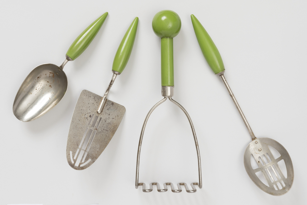 Potato masher, slotted spoon, measuring scoop and wedge shaped server or spatula, all of chrome=plated steel or steel wire with green-painted wooden handles.