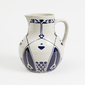 White ovoid jug with strap handle and spout with Jugendstil designs in cobalt blue.