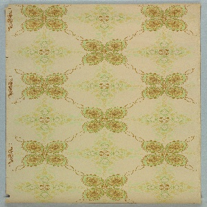 Trellis or grid pattern featuring alternating leaf-like quatrefoils with scalloped border and beige medallions containing radial, foliate designs. Beaded swags create the borders between quatrefoils and medallions. Printed in browns, yellows and greens on khaki ground.