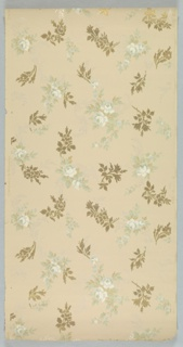 Non-directional, seemingly random placement of floral sprigs in blue, green, white, and tan, alternate with sprigs in metallic gold. Printed on tan ground.