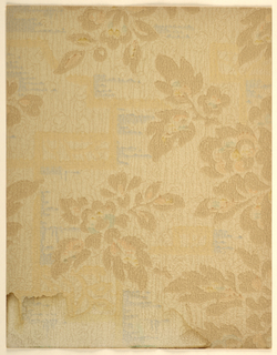 Modernist/Art Deco double-layered pattern with stylized leafy branches on a background with abstract rectilinear design; branches are rendered in stencil-like effect with uniform color and lack of detail; underlying geometric pattern formed from thick blurred lines with edging of irregular horizontal streaks on right side; paper has applied woodgrain texture; color scheme of brown branches and grain pattern, dark tan geometric lines, blue streaks on pale tan ground.