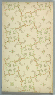 Quatrefoil motif formed with four acanthus scrolls, alternates with motif of foliate and floral scrolls, forming a grid or trellis pattern. Printed in red, green, gray, and metallic gold on off-white ground.