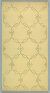 Repeating motif of overlapping circles, set in rows. A small diamond shape is set in the intersection on two sides. Printed in metallic gold, green and brown on off-white ground.