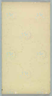 Widely-spaced pattern with foliate scroll enclosing floral sprig, with tendrils branching out from end. Printed in gray, blue, and tan on light colored ground.
