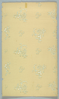 Widely spaced scrolling acanthus motif, altnerating large and small. Printed in blue, green, and white on tan or off-white ground.
