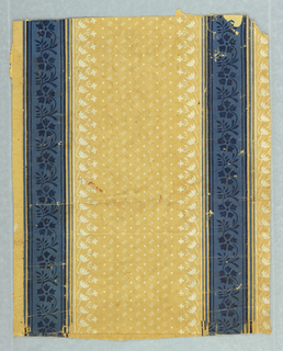 Blue floral stripe, with band of stylized vining floral motif on either side. Printed in blue and white on tan background covered with pattern of dots and dashes.